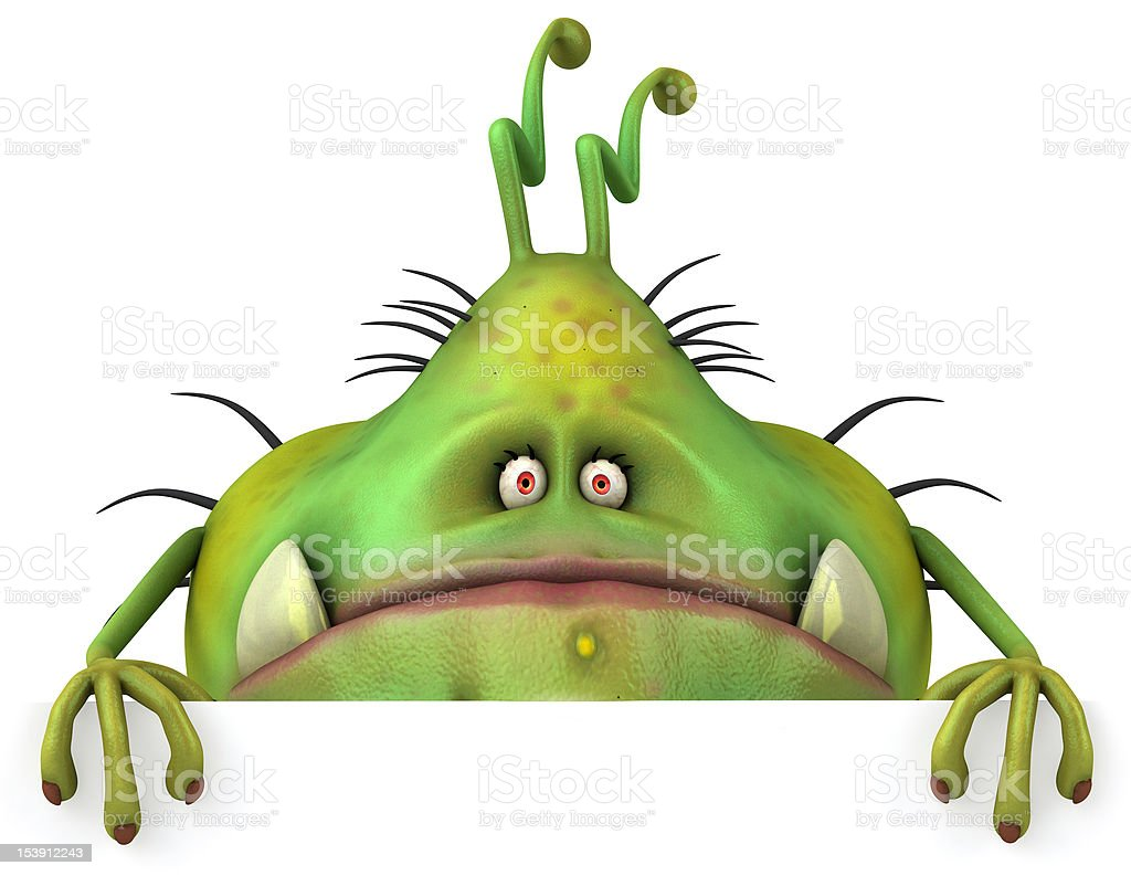 Green monster with buckteeth fangs frowning stock photo