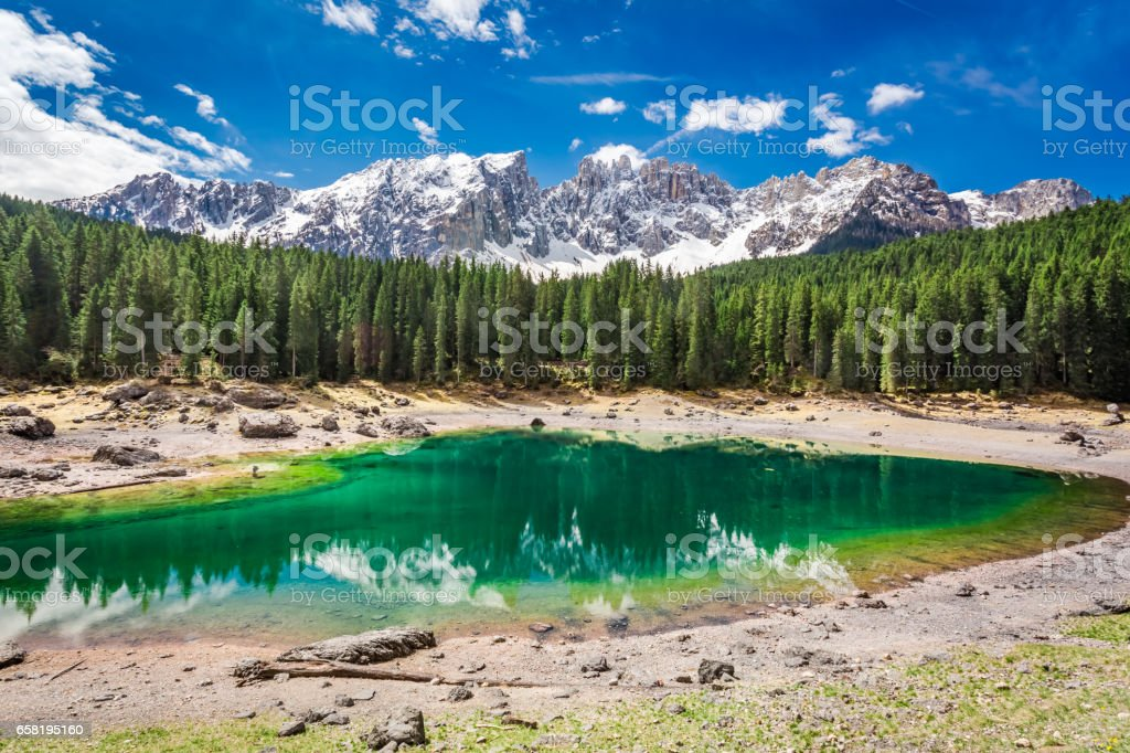 Green mountain Carezza lake in spring, Alps, Italy, Europe stock photo
