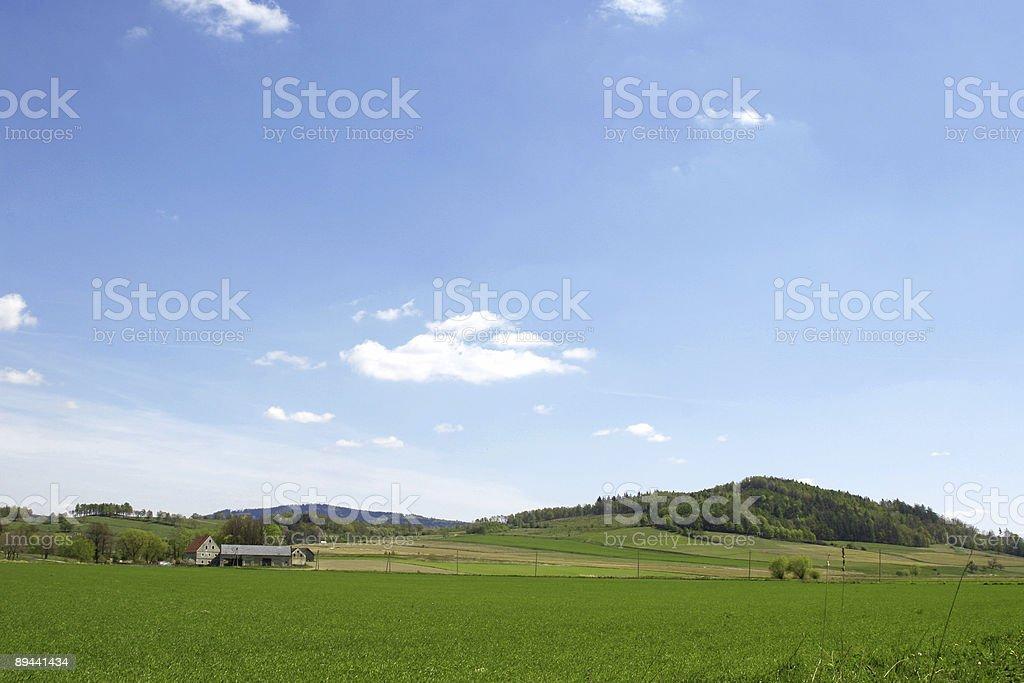 Green mountain field and farm royalty-free stock photo