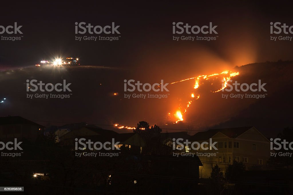 Green Mountain Fire Lakewood Colorado flames above neighborhood homes night stock photo