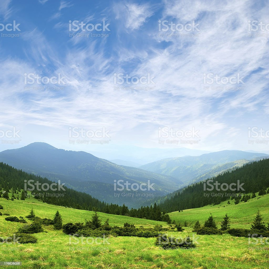 green mountain valley and sky stock photo