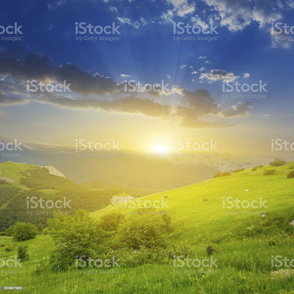 green mountain valley at the evening stock photo