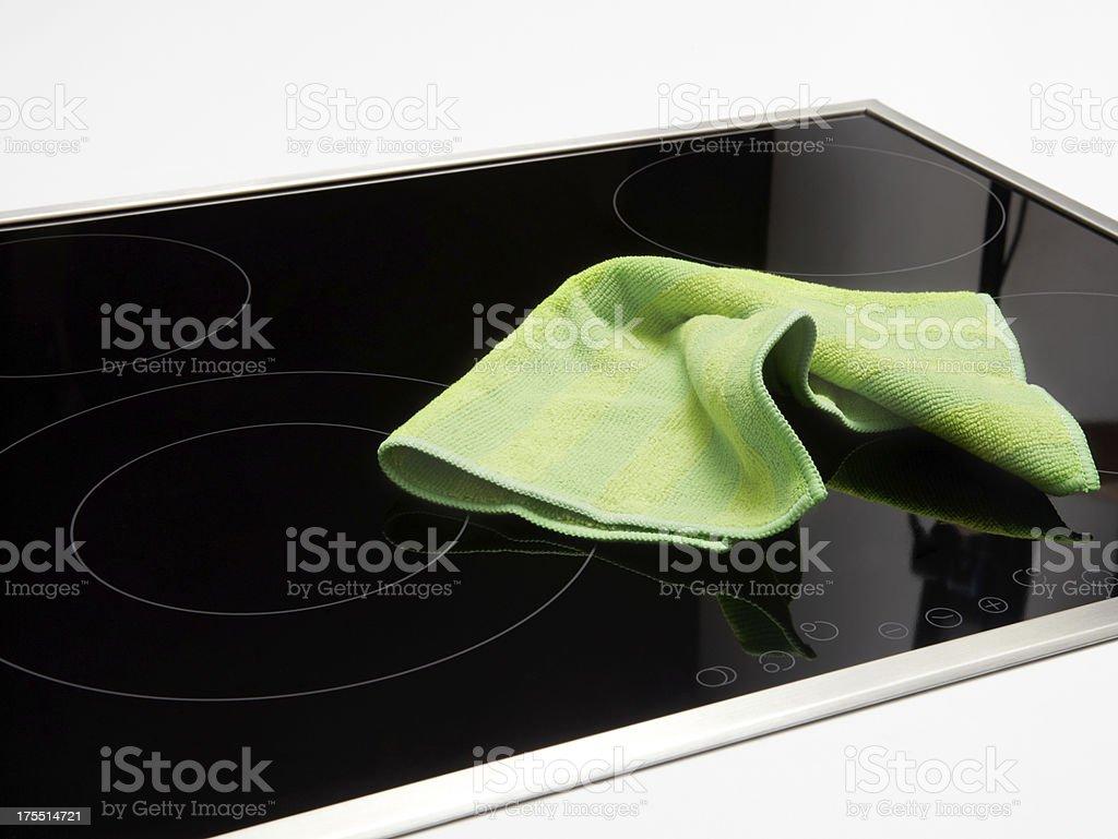 Green Napkin On The Stove stock photo
