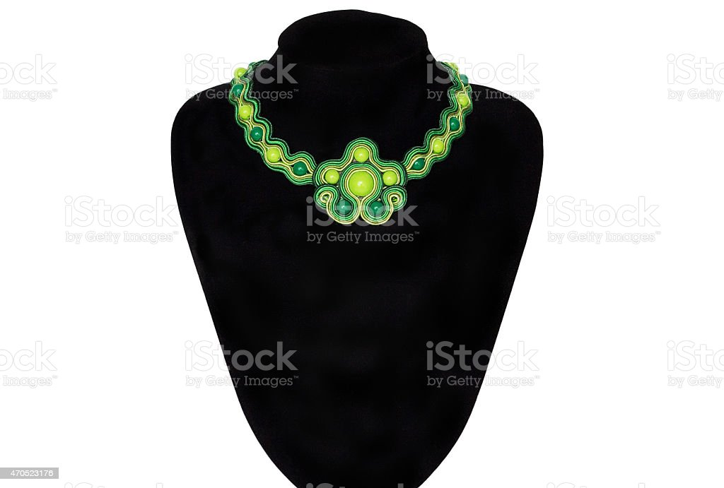 Green necklace on a rack stock photo