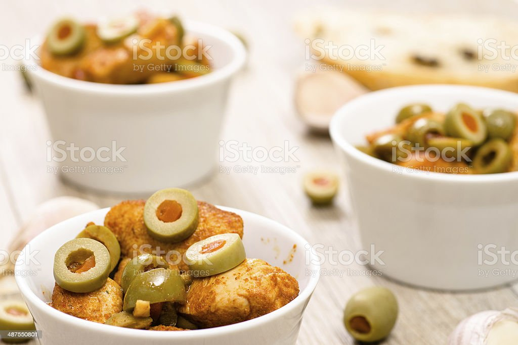 Green olives and roasted chicken stock photo