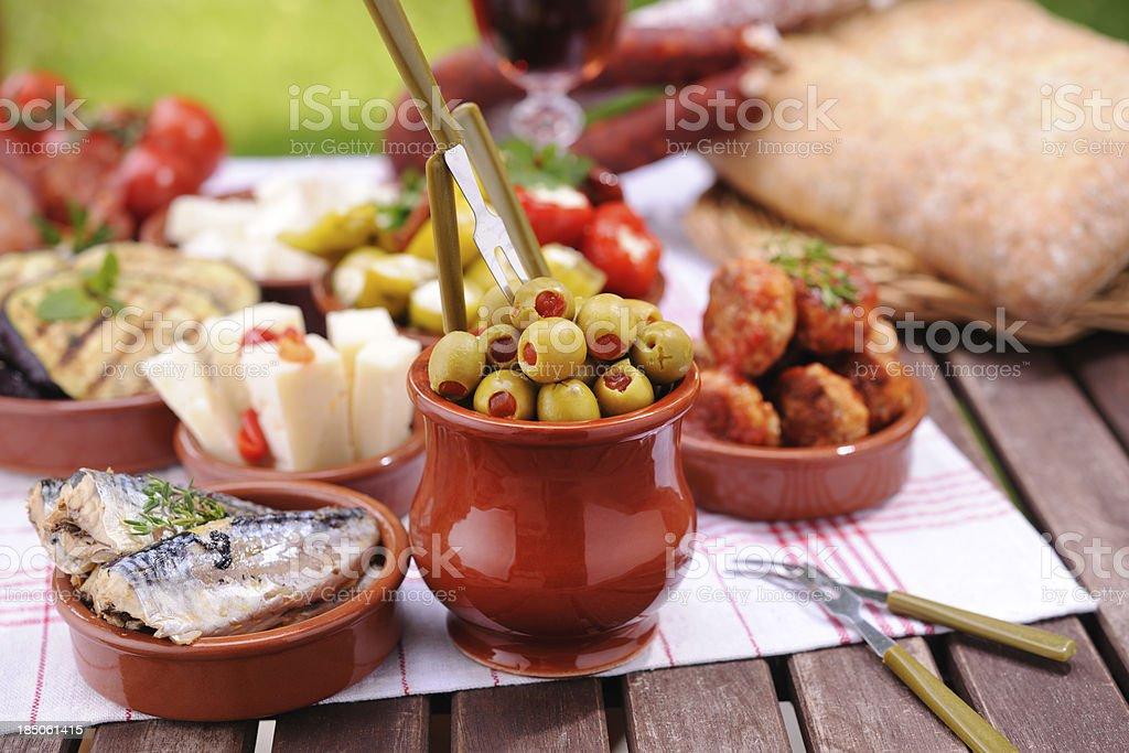 Green olives and various tapas plates royalty-free stock photo