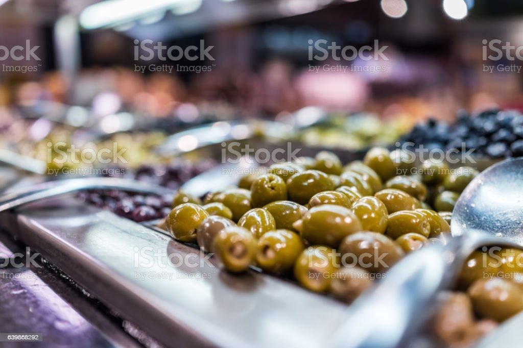 Green olives stuffed with garlic in bar macro closeup stock photo