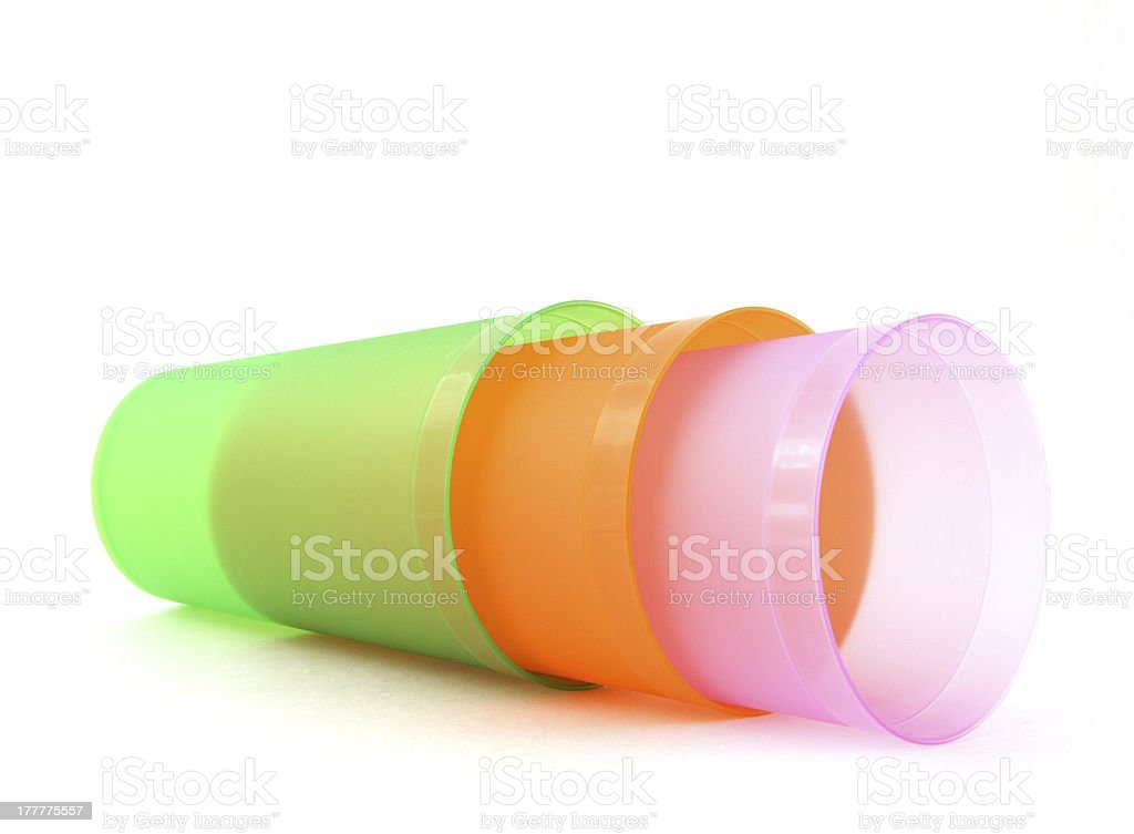 Green, orange and pink cups royalty-free stock photo