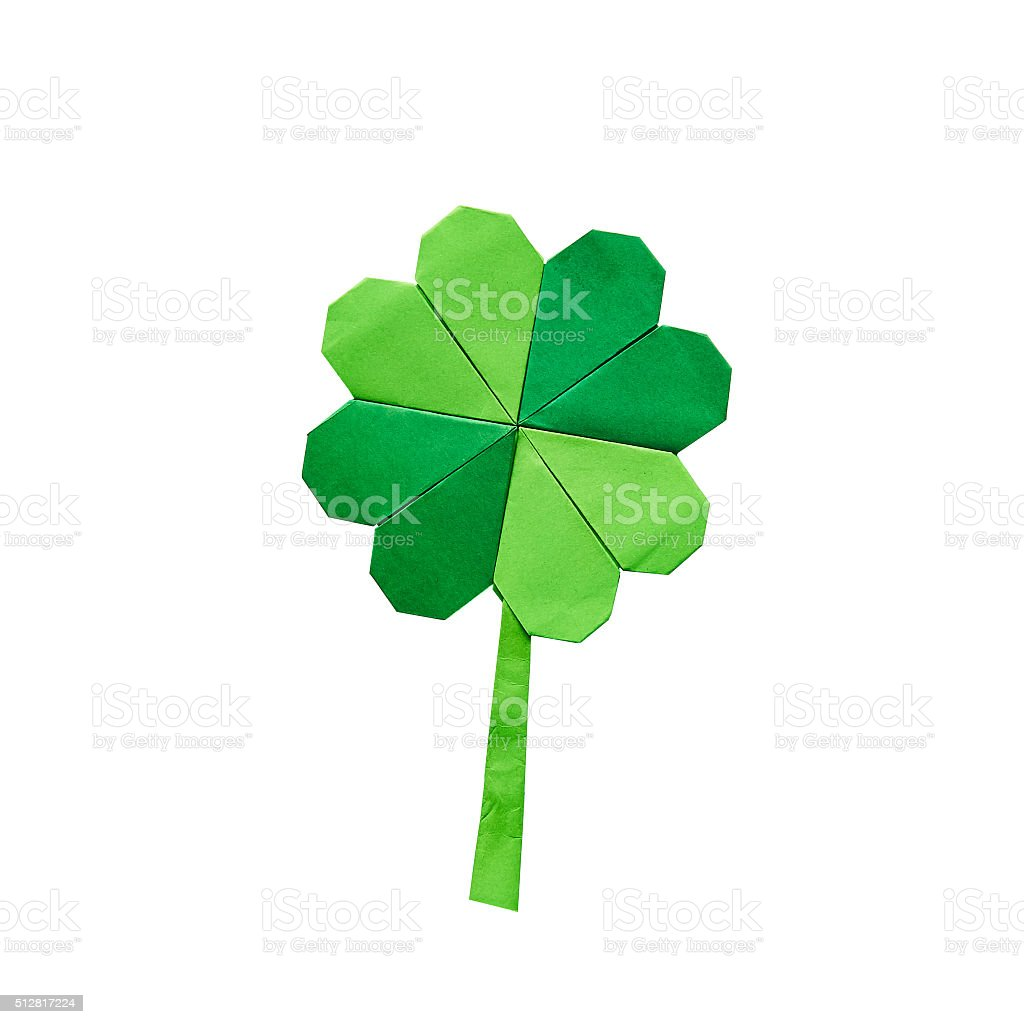 Green origami paper shamrock clover leaf on white background stock photo