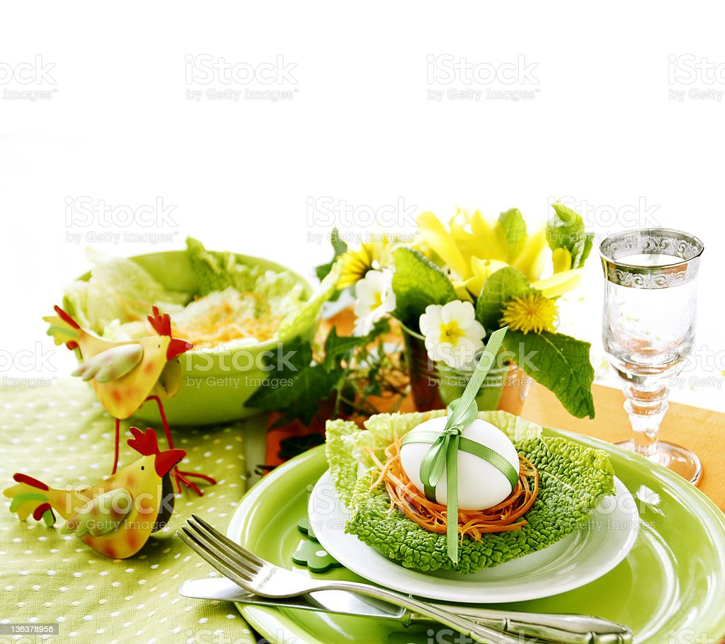 Green ornate Easter table setting on white background royalty-free stock photo