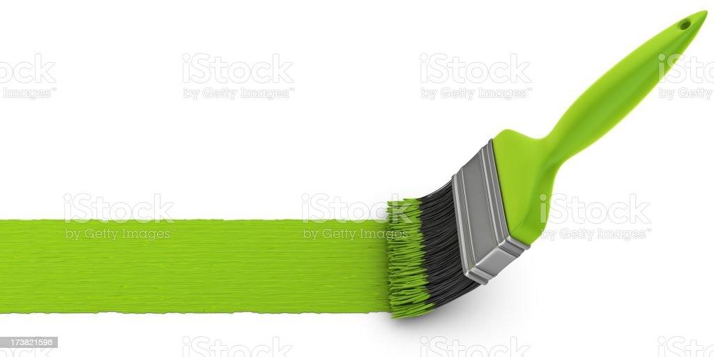 green paint brush stock photo