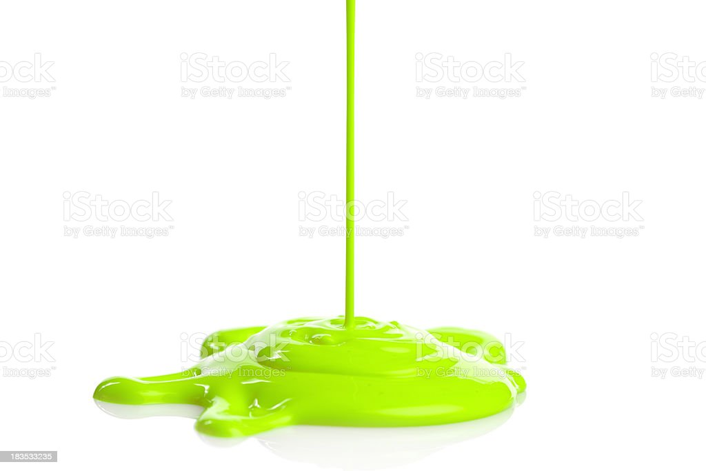 green paint dripping stock photo