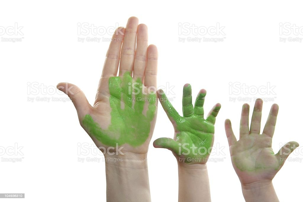 Green paint mother, son, daughter hand royalty-free stock photo