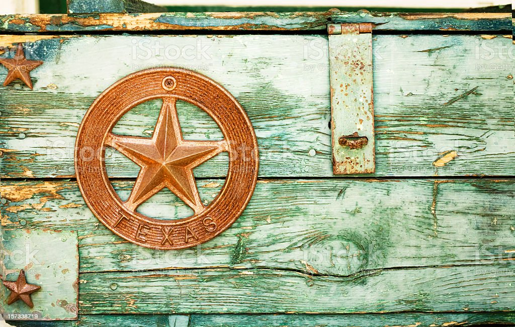 Green paint peeling on Wooden box with Texas star stock photo