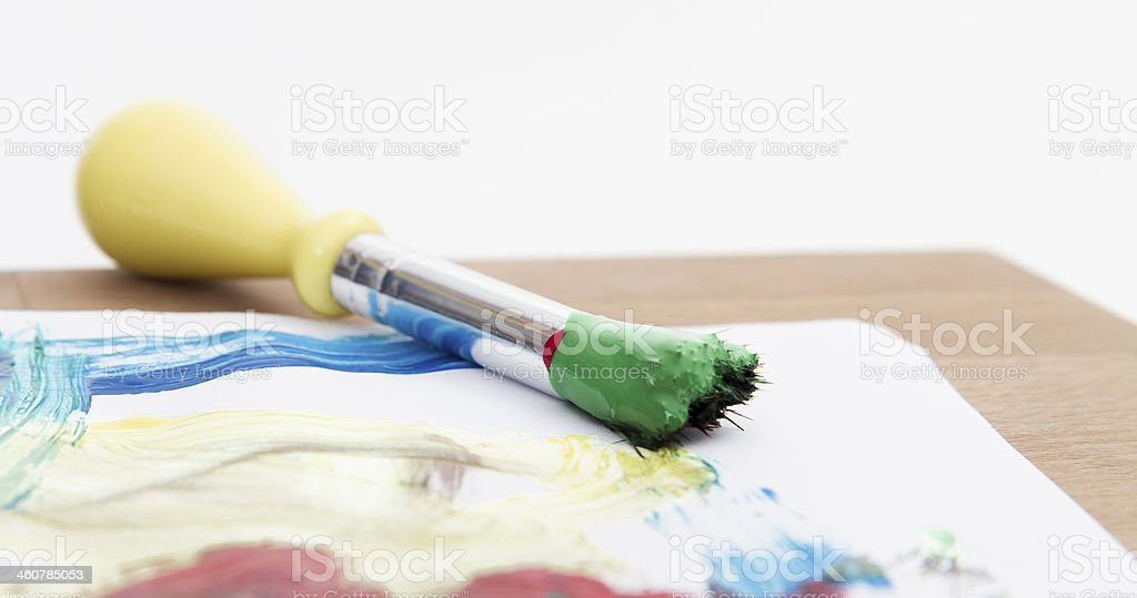 green paint with brush stock photo