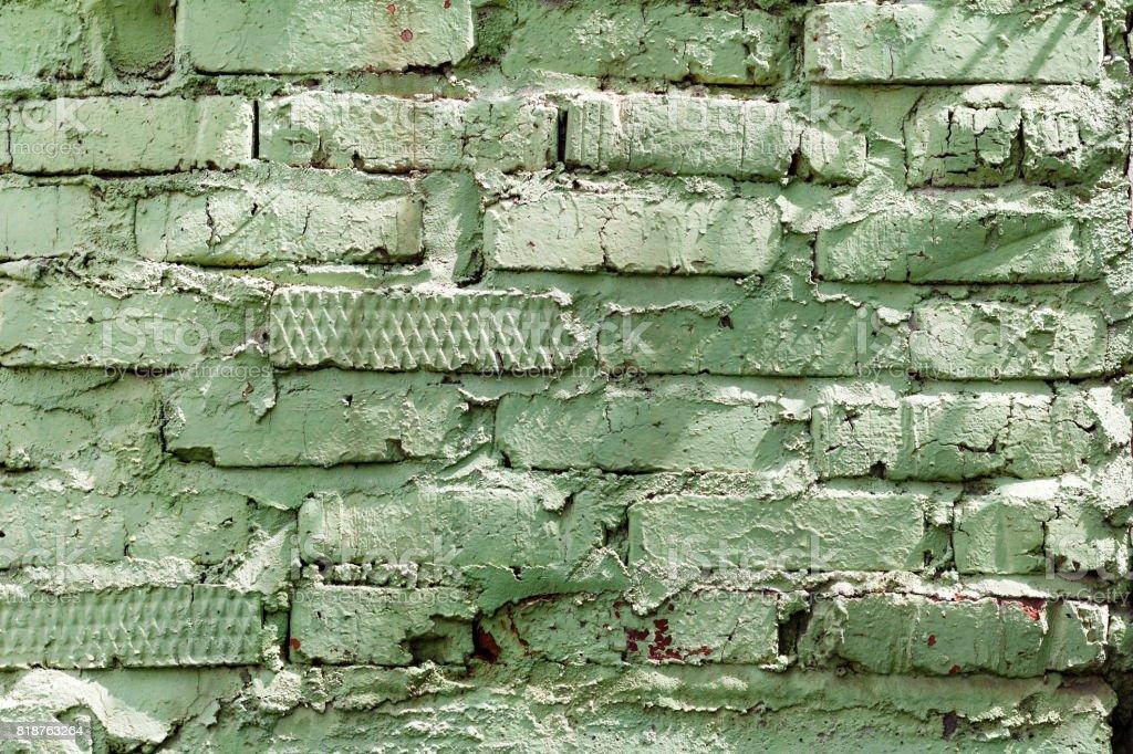 Green painted brick wall texture. Abstract brick wall background stock photo