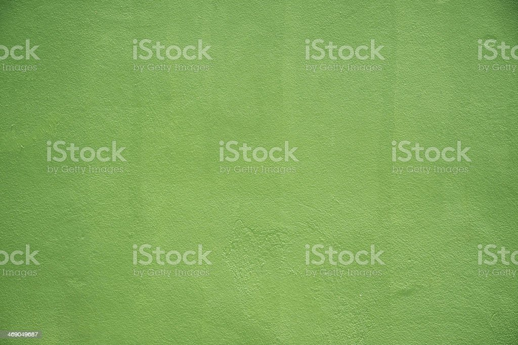 green painted cement wall stock photo