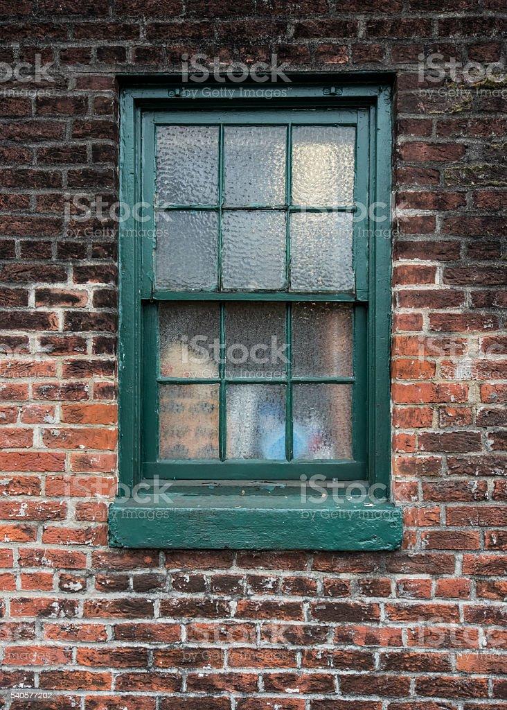 Green Painted Window on Brick Wall stock photo