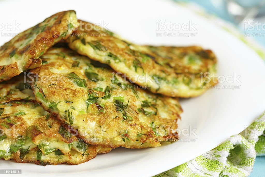 Green pancakes with zucchini and herbs stock photo