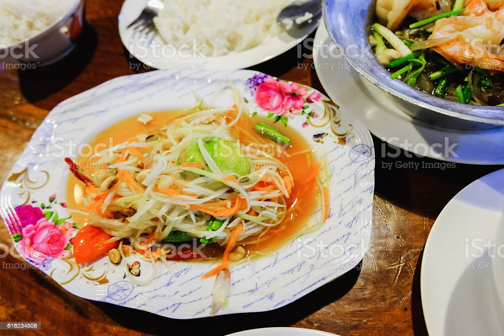 Green Papaya Salad (Som tum Thai) on the table stock photo