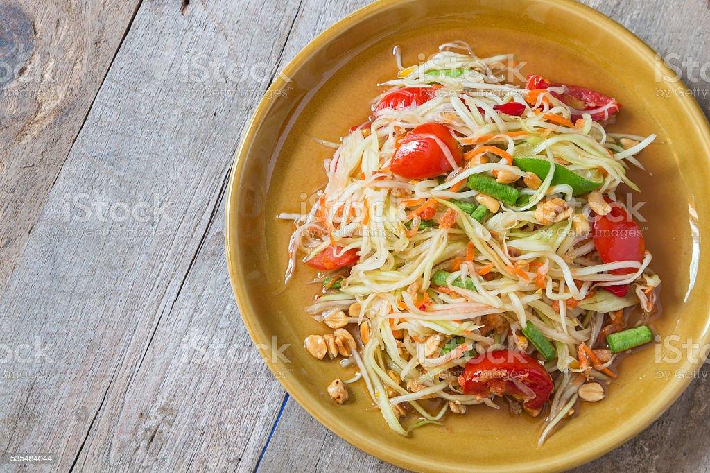 Green Papaya Salad on wood table stock photo