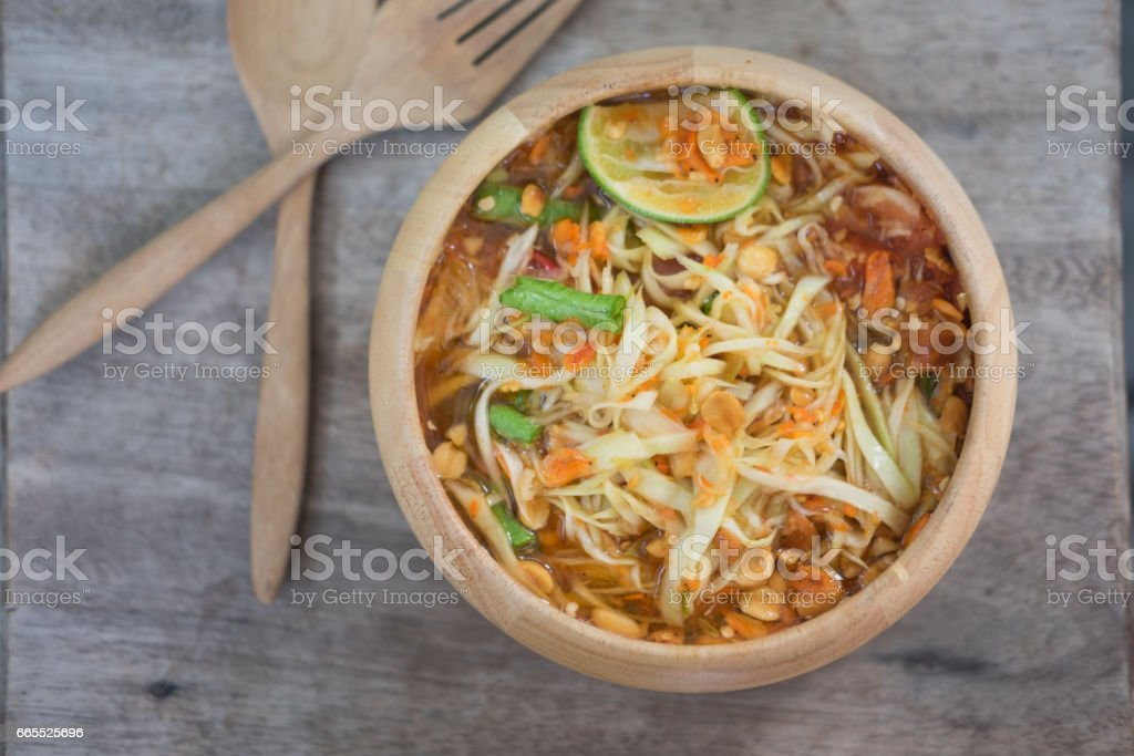 Green Papaya Salad (Som tum Thai) on wood table stock photo