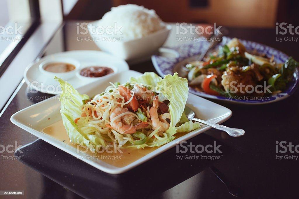 Green papaya salad. Thai dinner. stock photo