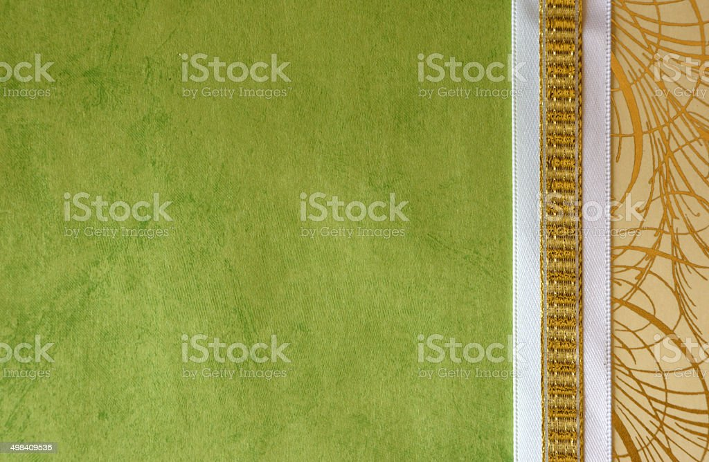 Green Paper Background with Gold Ribbon Border stock photo