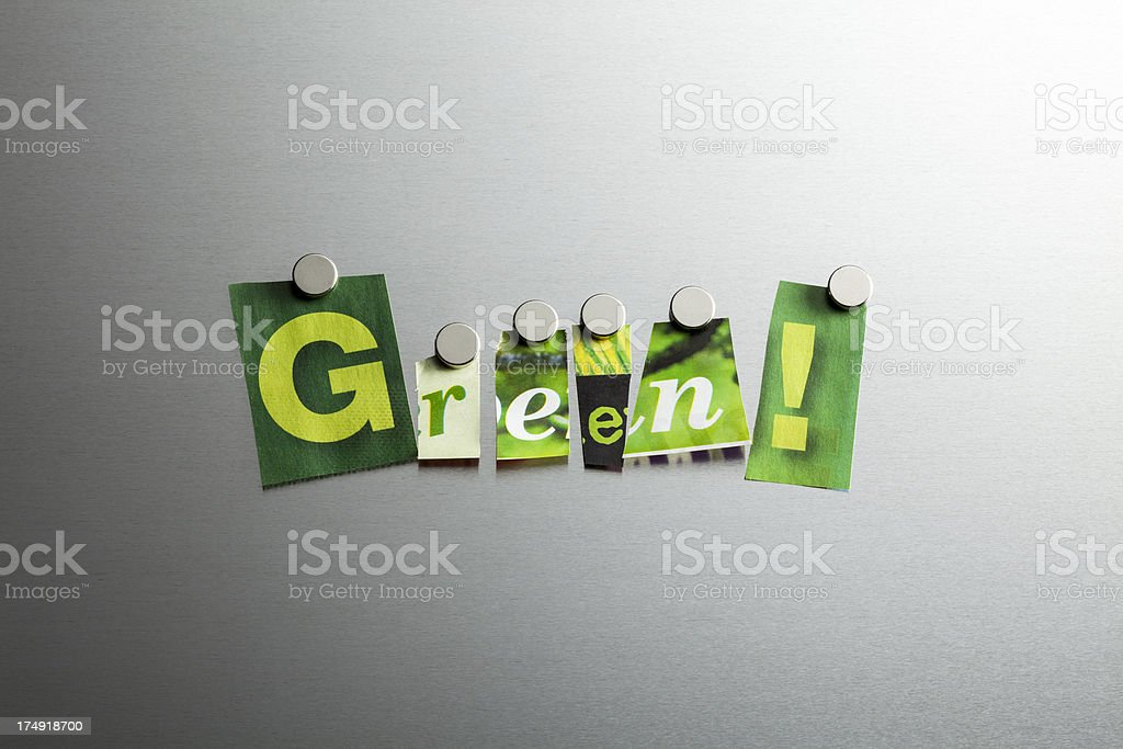 Green Paper Snippets on Brushed Metal royalty-free stock photo