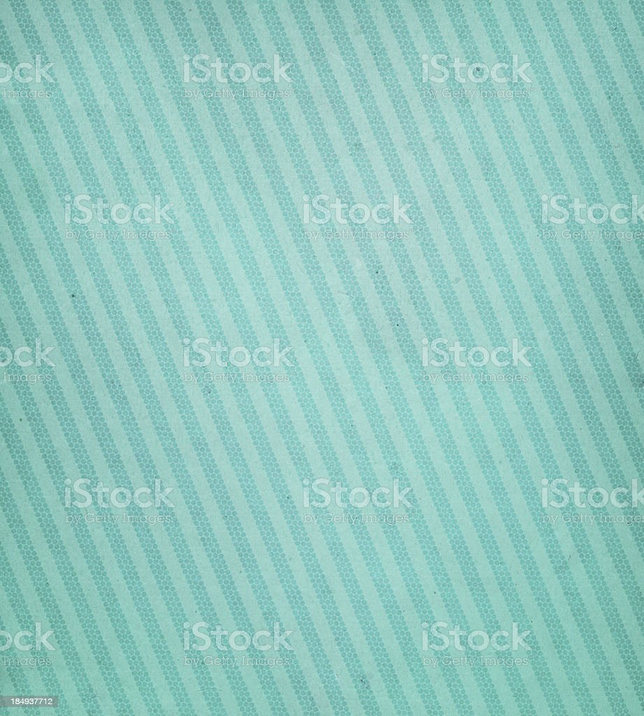 Green paper with diagonal lines stock photo