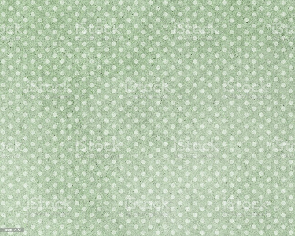 green paper with dots stock photo
