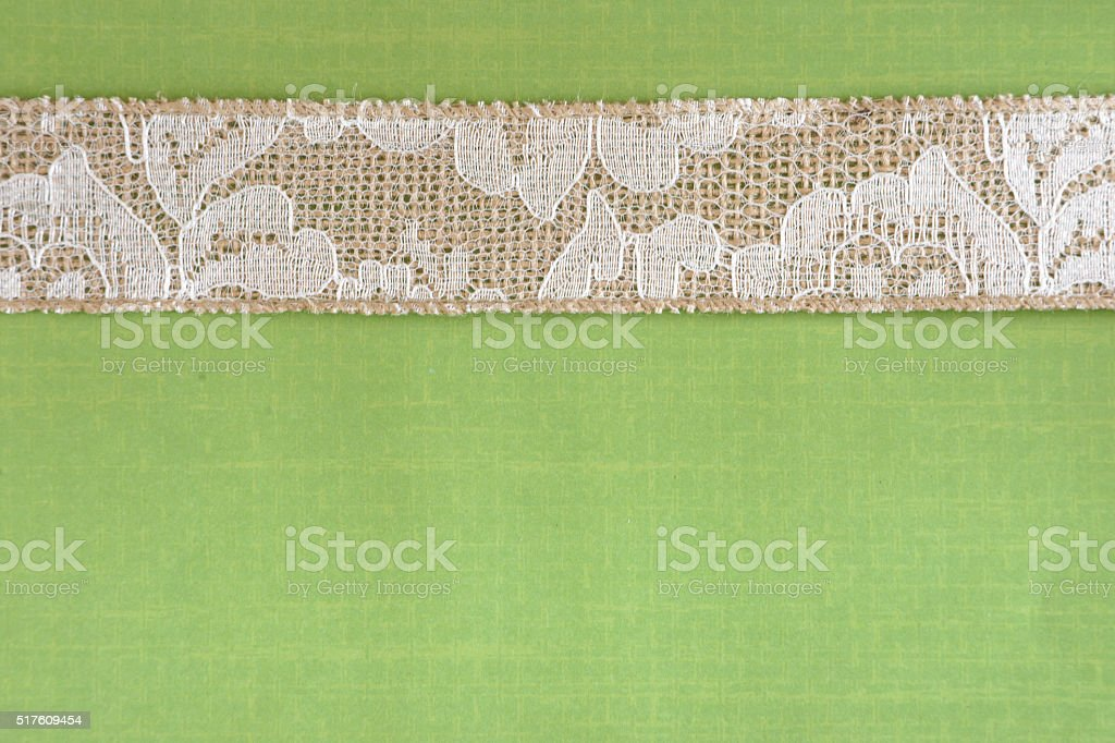 Green Paper with White Lace and Burlap Border stock photo