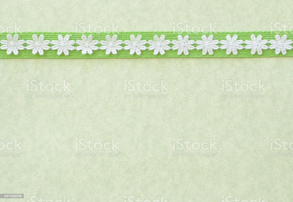 Green Paper with White Lace Border stock photo