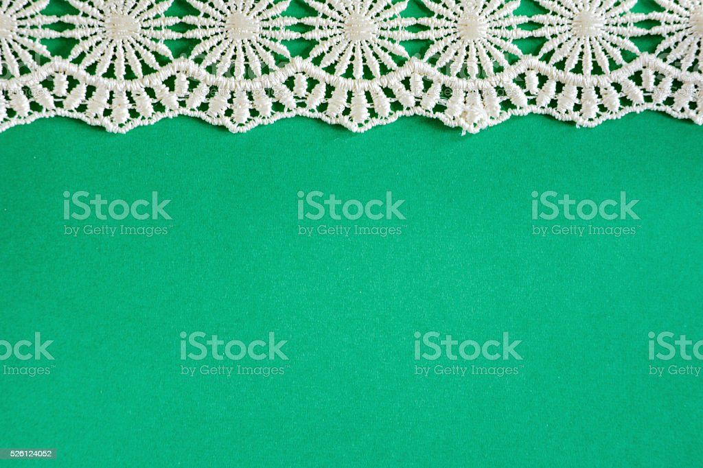 Green Paper with White Lace stock photo
