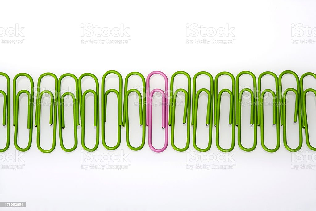 Green Paperclips in a row stock photo