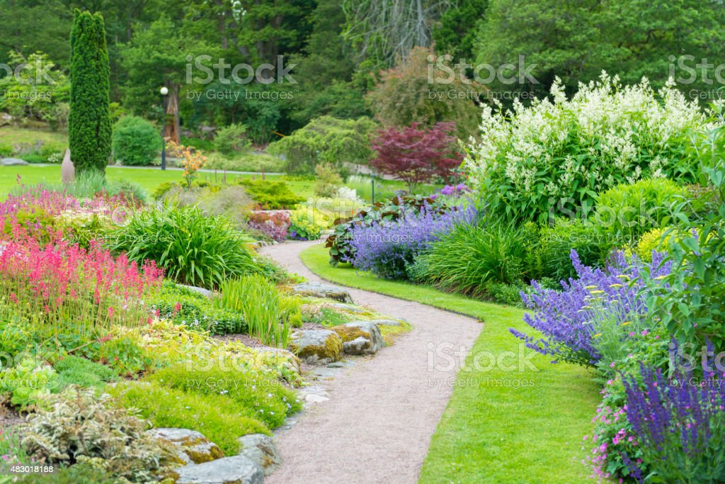 Green park flowerbeds stock photo