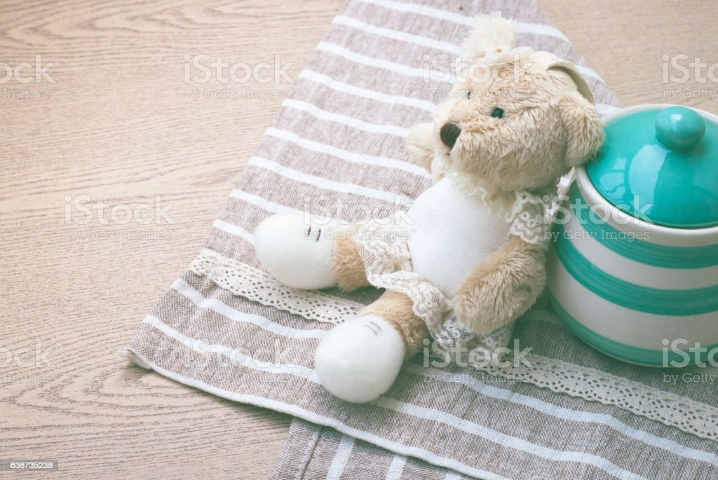 Green pastel porcelain jar and little bear doll. stock photo