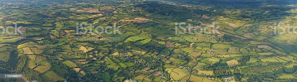 Green patchwork landscape aerial panorama farms fields stock photo
