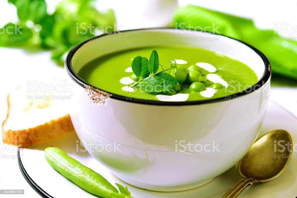 Green pea creamy soup. stock photo