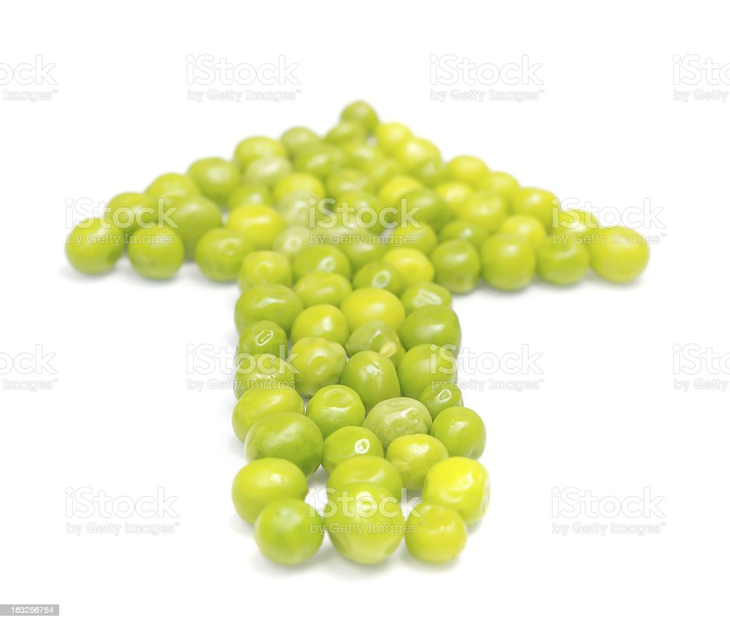 Green pea pods in the shape of an arrow royalty-free stock photo