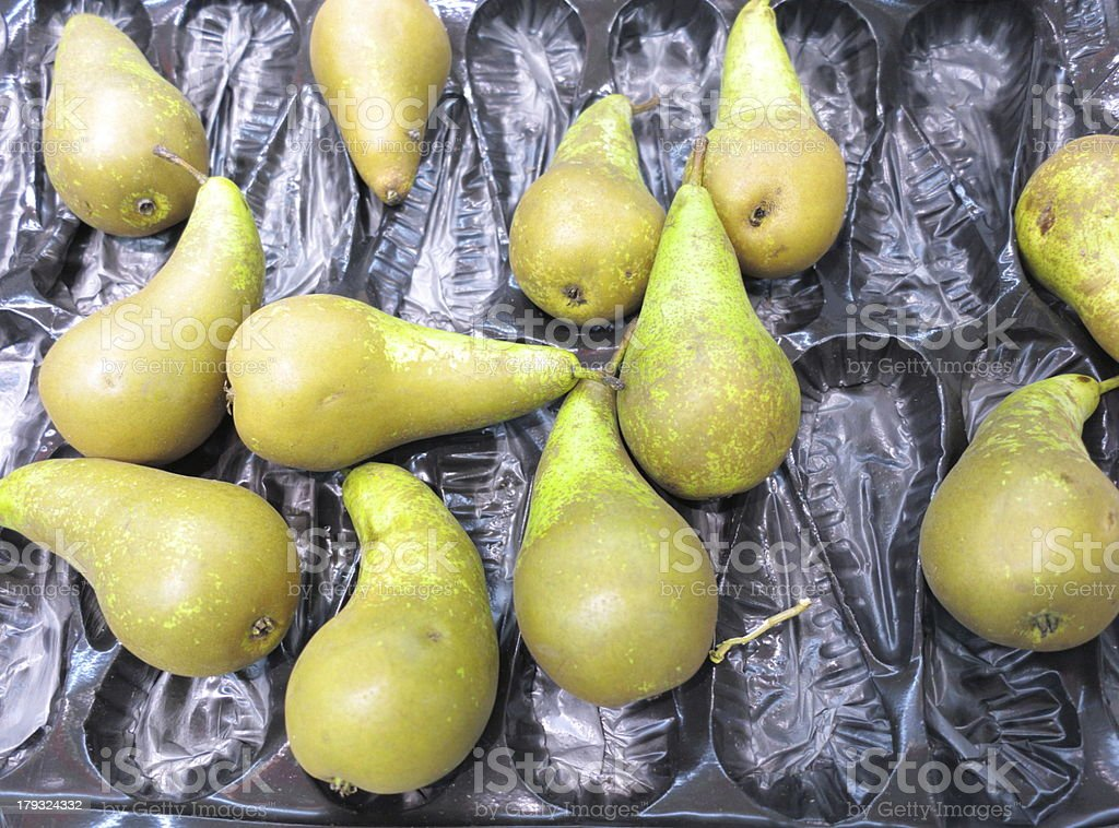 Green pears fruits in box for sale, market royalty-free stock photo