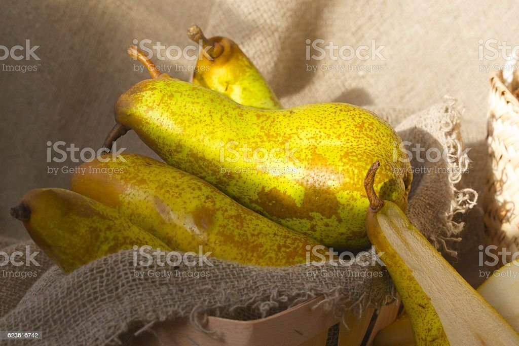 Green pears on a sackcloth stock photo