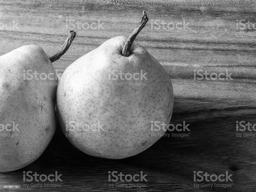 Green Pears on Board in Black and White stock photo