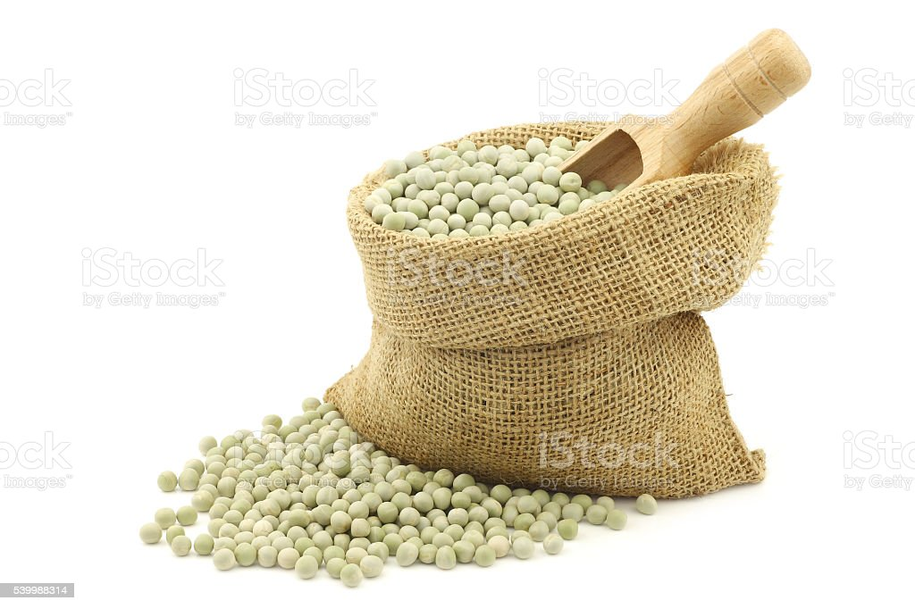 green peas in a burlap bag stock photo