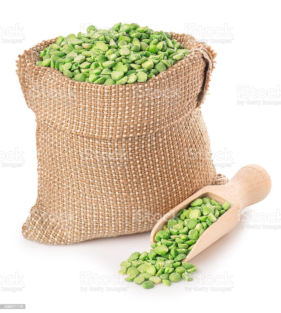 Green peas in bag with scoop isolated on white stock photo