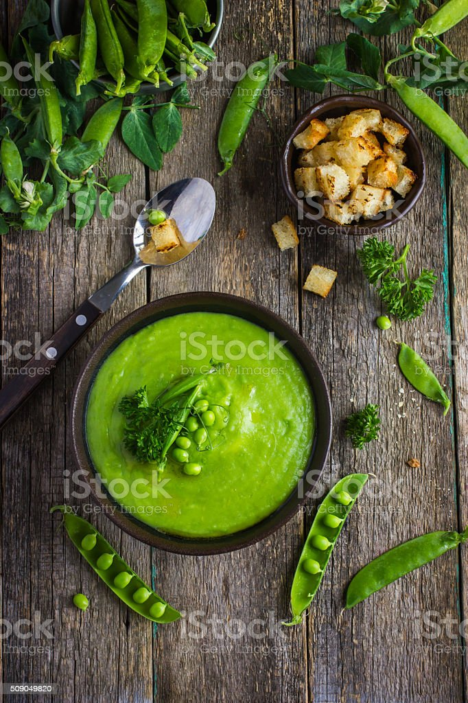 green peas soup on rustic background stock photo