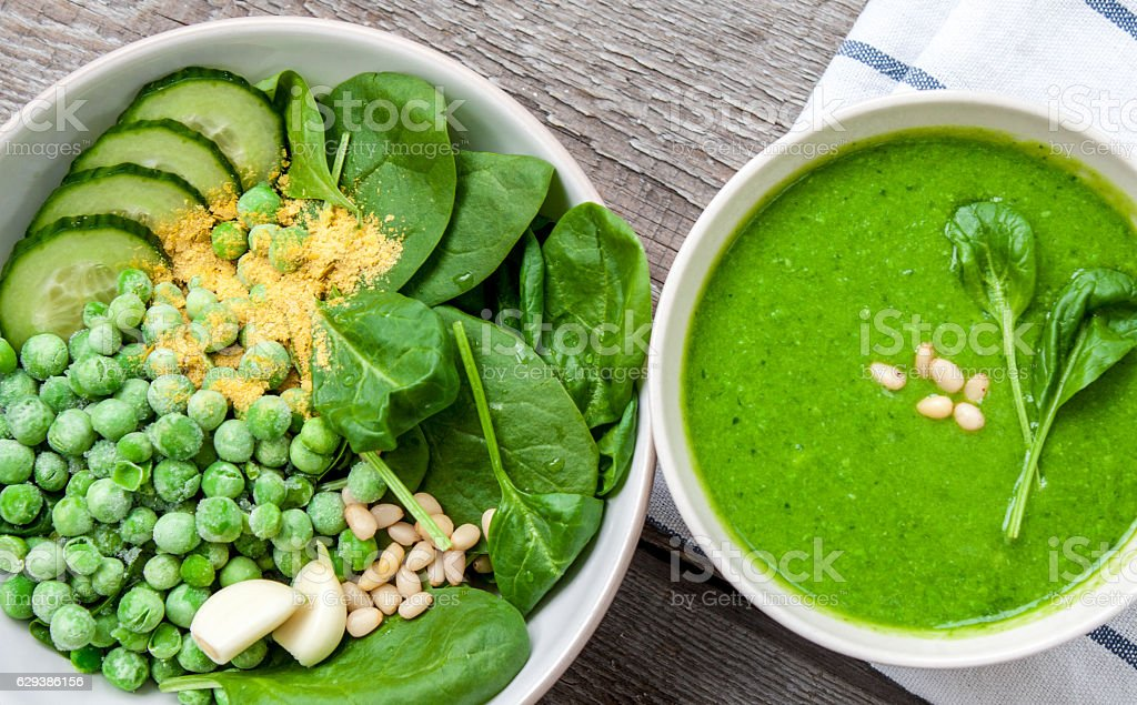 Green peas spinach basil pesto and Ingredients stock photo