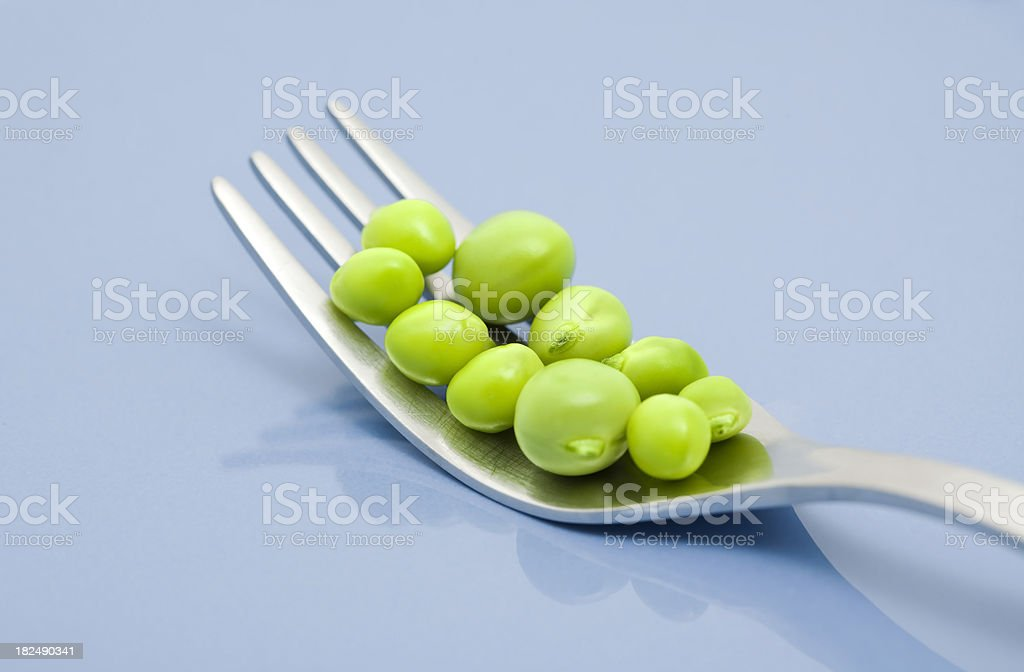 green peas with fork royalty-free stock photo