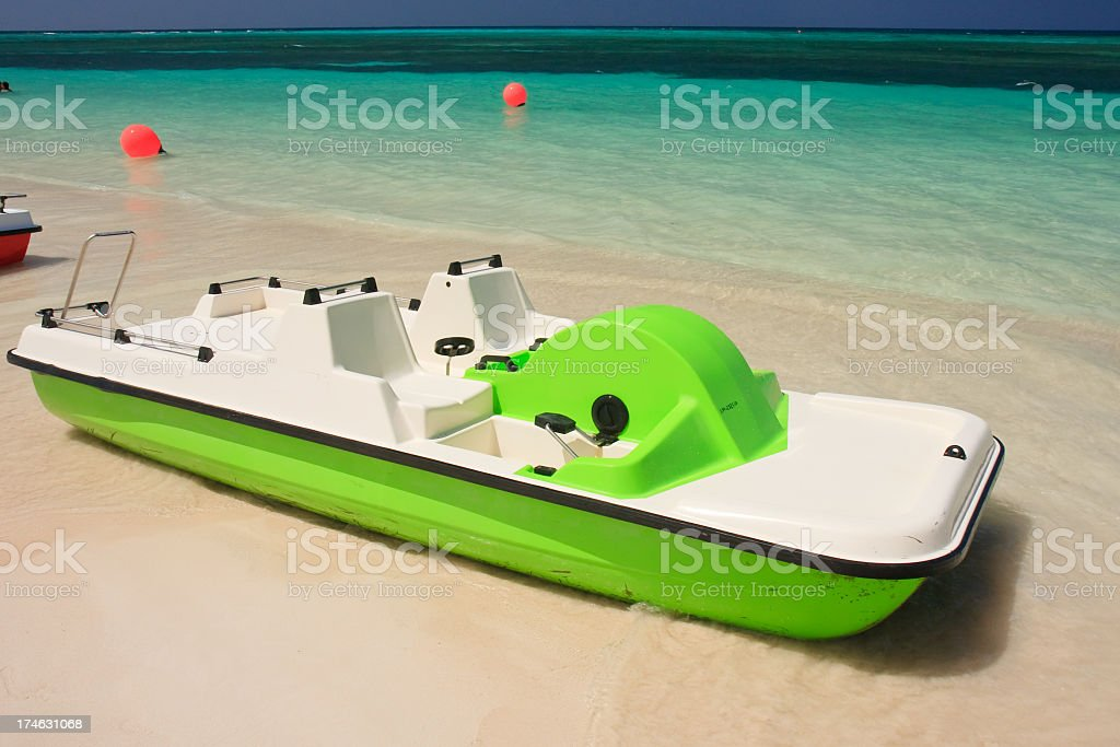 Green pedal boat stock photo