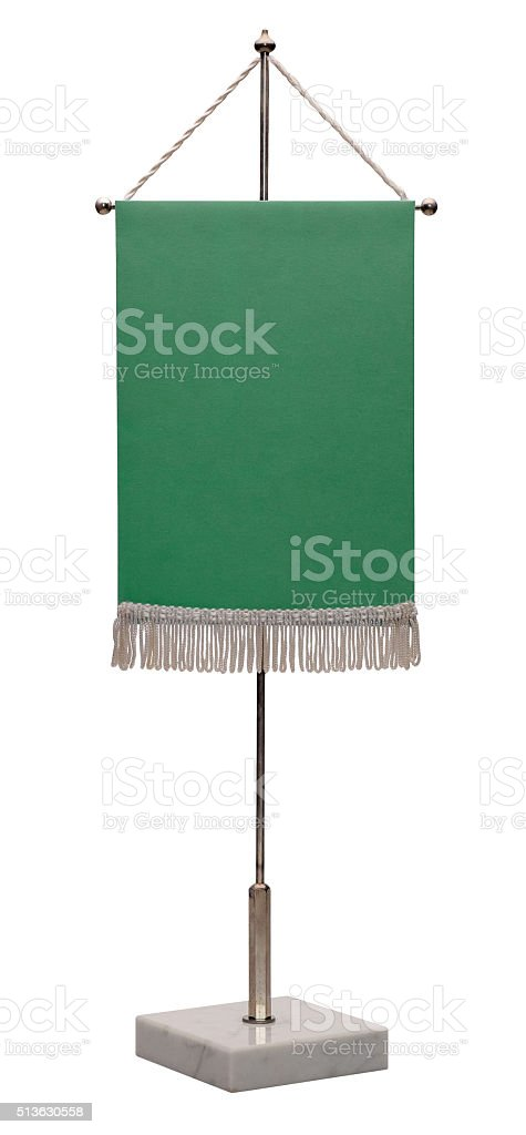 Green pennant on steel spire on a marble pedestal. stock photo